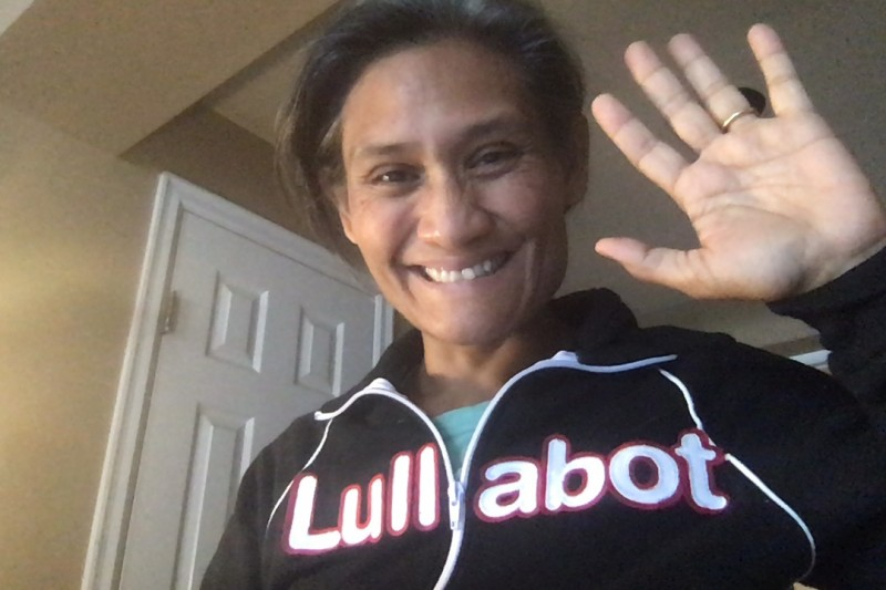 Monica wearing Lullabot jacket and waving hello