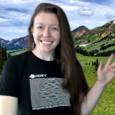 Long haired person in front of Colorado mountains on a greenscreen with the ddev logo